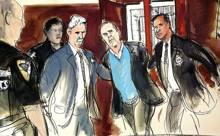 In this courtroom sketch, Harvey Weinstein, center, is escorted into New York County Criminal Court in New York on Friday, May 25, 2018. Weinstein was arraigned Friday on rape and other charges in the first criminal prosecution to result from the wave of allegations against him that sparked a national reckoning over sexual misconduct.