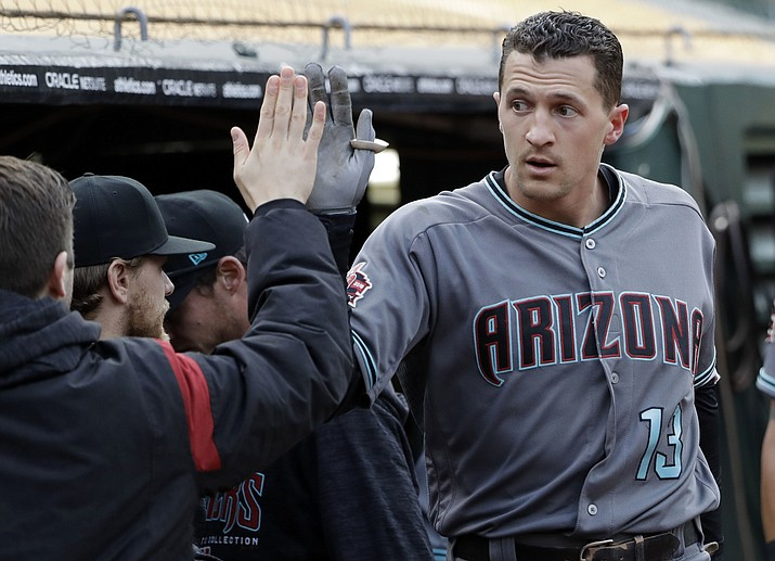 Arizona Diamondbacks' Nick Ahmed receives a high-five in the dugout after hitting a solo home run against the Oakland Athletics during the first inning of a baseball game Friday, May 25, 2018, in Oakland, Calif. (Marcio Jose Sanchez/AP)