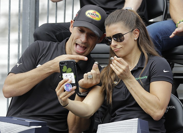 Tony Kanaan, of Brazil, and Danica Patrick take a selfie with their rings during the drivers meeting for the Indianapolis 500 auto race at Indianapolis Motor Speedway, in Indianapolis Saturday, May 26, 2018. (Darron Cummings/AP)