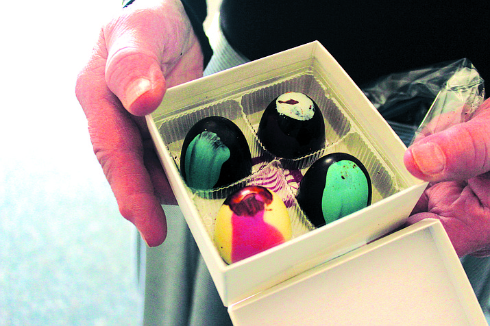 Gayle Harte holds a box of her hand-crafted chocolates. VVN/Kelcie Grega