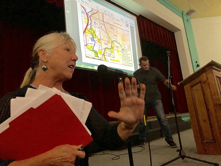 Area resident Joyce Van Walsum, left, urges Jason Gisi of Arizona Eco Development to be responsible in his pending development of the Granite Dells property near the Point of Rocks. Van Walsum was one of more than a dozen people who spoke during a public open house on the project Thursday, May 24. (Cindy Barks/Courier)