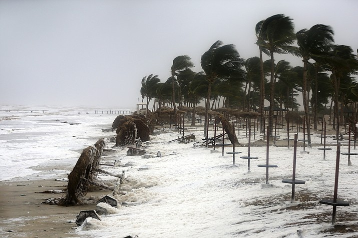 Debris and sea foam litters a beach after Cyclone Mekunu in Salalah, Oman, Saturday, May 26, 2018. Cyclone Mekunu blew into the Arabian Peninsula on Saturday, drenching arid Oman and Yemen with rain, cutting off power lines, officials said. (AP Photo/Kamran Jebreili)