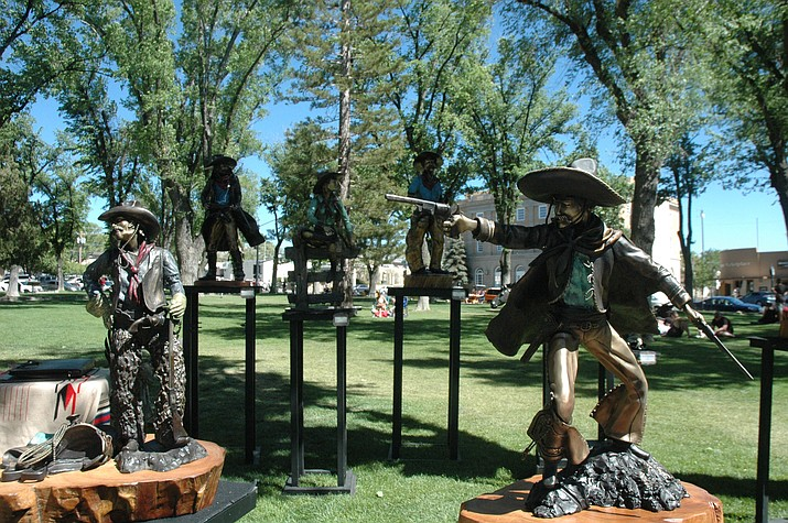 Bronze cowboys created by Steven Schneider at the 44th annual Phippen Western Art Show & Sale on the courthouse plaza Saturday, May 26. (Jason Wheeler/Courier)