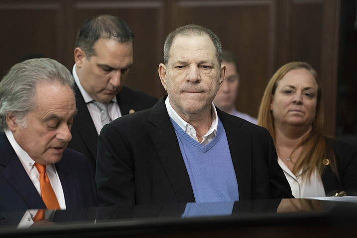 Harvey Weinstein, center, listens during a court proceeding in New York on Friday, May 25, 2018. Weinstein was arraigned Friday on rape and other charges in the first criminal prosecution to result from the wave of allegations against him that sparked a national reckoning over sexual misconduct. (Steven Hirsch/New York Post via AP, Pool)