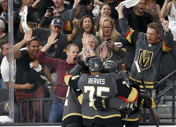 In this Friday, May 18, 2018, file photo, Vegas Golden Knights left wing Tomas Nosek, left, celebrates with teammates after scoring against the Winnipeg Jets during the second period of Game 4 of the NHL hockey Western Conference finals in Las Vegas. The love affair between a city and its new team wasn't totally unexpected. Las Vegas was, after all, a town starved for major league sports. (AP Photo/John Locher, File)