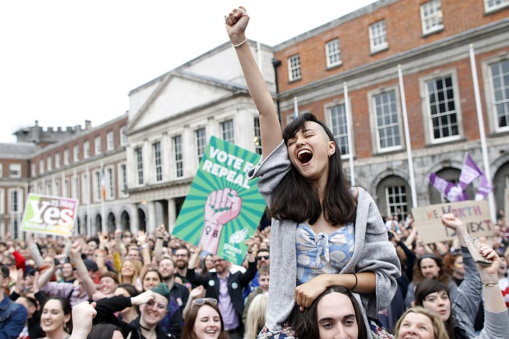 "A woman from the ""Yes"" campaign reacts after the final result was announced, after the Irish referendum on the 8th Amendment of the Irish Constitution at Dublin Castle, in Dublin, Ireland, Saturday, May 26, 2018. The prime minister of Ireland says the passage of a referendum paving the way for legalized abortions is a historic day for his country and a great act of democracy. (Peter Morrison/AP)"