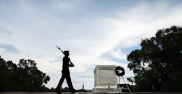 A member of the U.S. Army 3rd Infantry Regiment walks his post in front of The Tomb of the Unknown Soldier in Arlington National Cemetery during the Memorial Day weekend in Arlington, Virginia, Sunday, May 27, 2018. (AP Photo/J. David Ake)
