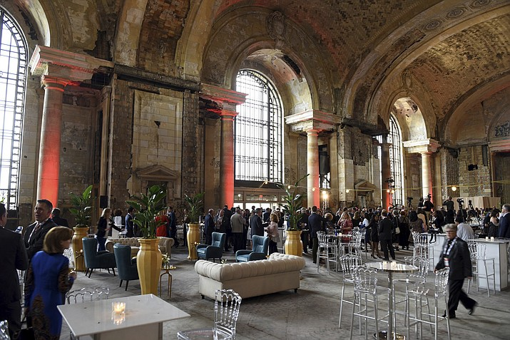 In this Sept. 13, 2017, file photo, guests attend Detroit Homecoming IV at Detroit's most iconic structure, the Michigan Central train station, which opened its doors for the first time since the 1980s. People living and working near the station are excited that the Ford Motor Co. is considering buying the massive old building, which has sat vacant for 30 years. Ford board member Edsel B. Ford II has said the company was in talks with the train station's owner about buying it, but some won't believe it until they see Ford move into the 105-year-old building. (Tanya Moutzalias /The Ann Arbor News via AP, File)