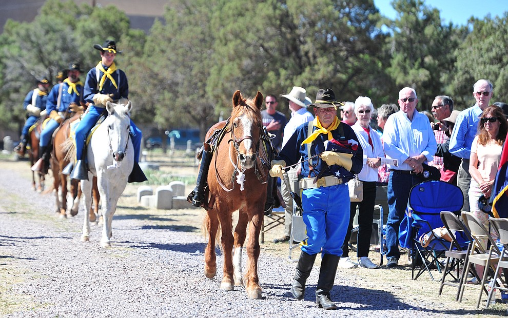 The Camp Verde Cavalry brings the American flag to be raised at the Citizens Cemetery Memorial Day program Monday, May 28, 2018 in Prescott Prescott. (Les Stukenberg/Courier)