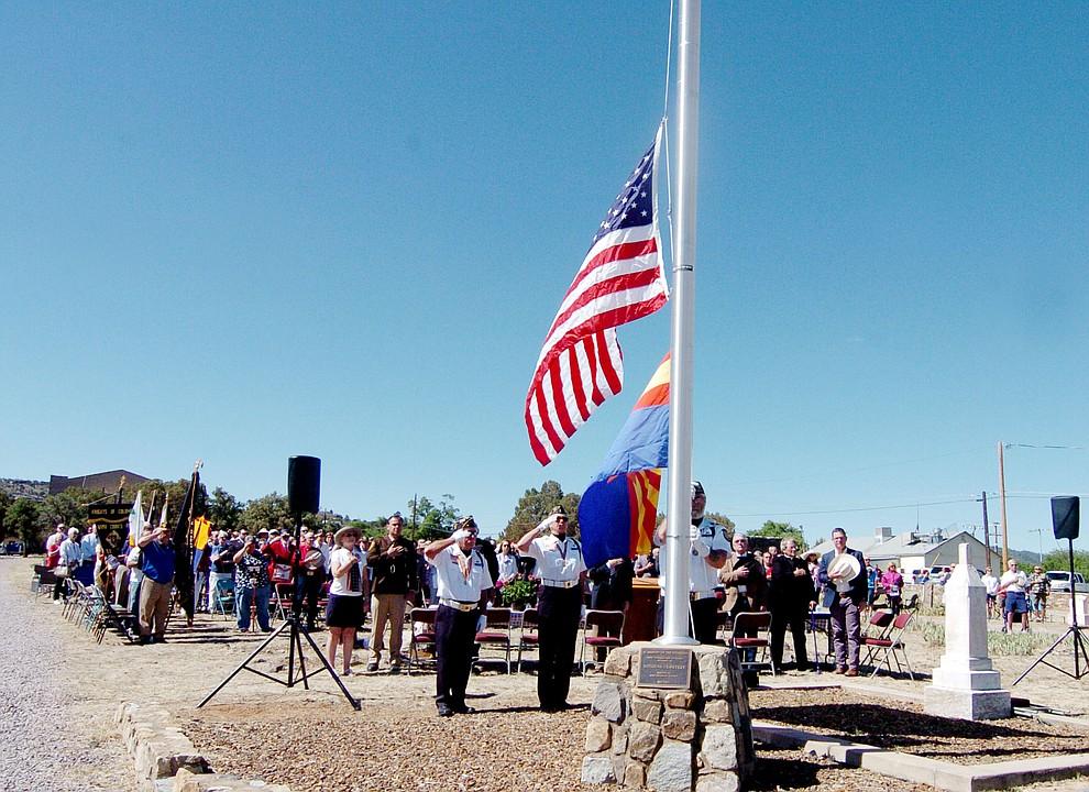 American Legion Post 6 Honor Guard raises the flag at the Citizens Cemetery Memorial Day program Monday, May 28, 2018 in Prescott Prescott. (Les Stukenberg/Courier)