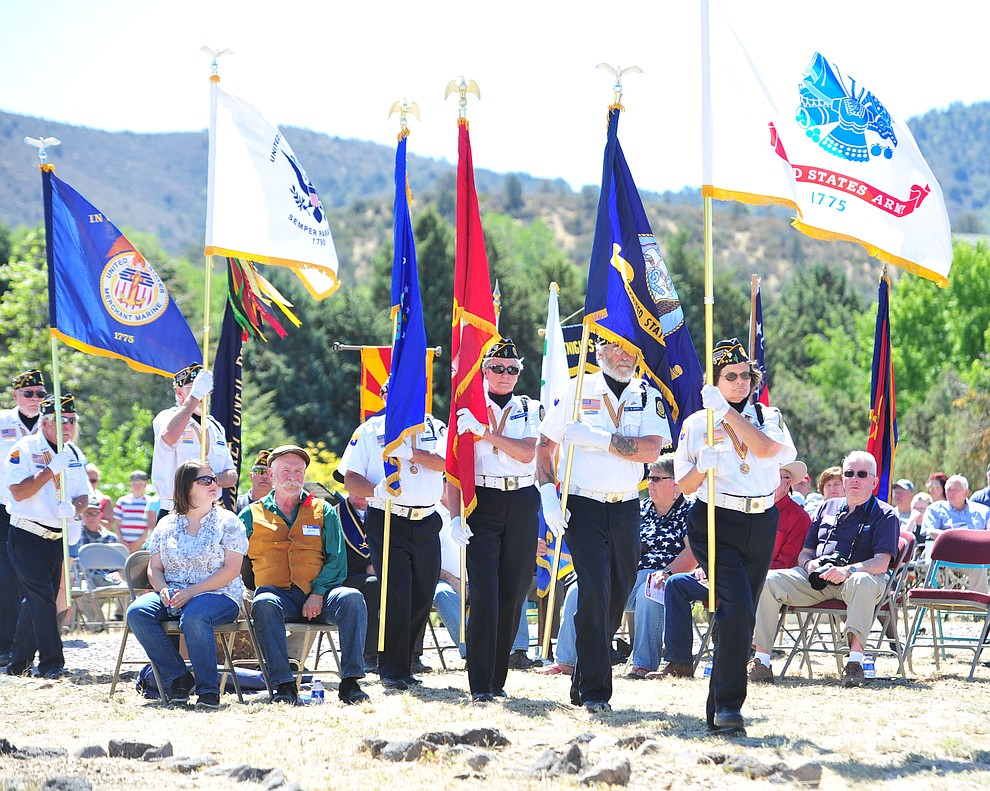 American Legion Post 6 Honor Guard presents flags of the different military branches during the Citizens Cemetery Memorial Day program Monday, May 28, 2018 in Prescott Prescott. (Les Stukenberg/Courier)