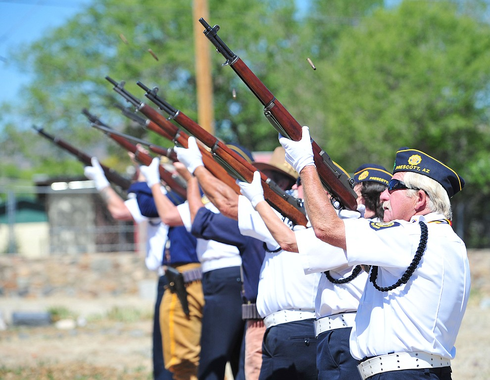 Members of the American Legion Post 6 and Arizona Rough Riders give a rifle salute at the end of the Citizens Cemetery Memorial Day program Monday, May 28, 2018 in Prescott Prescott. (Les Stukenberg/Courier)