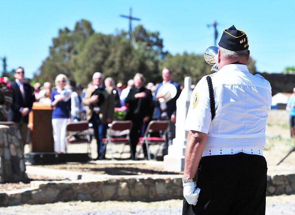 American Legion Post 6 bugler Bradley Moors plays taps at the Citizens Cemetery Memorial Day program Monday, May 28, 2018 in Prescott Prescott. (Les Stukenberg/Courier)