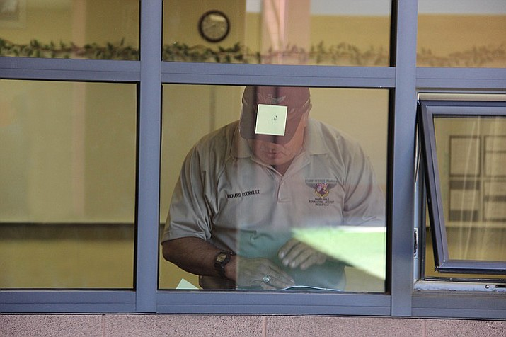 Richard Rodriguez takes notes while touring Bright Futures Pre-school in Prescott Valley for an Embry-Riddle Aeronautical University study on school safety he's assisting with. (Max Efrein/Courier)