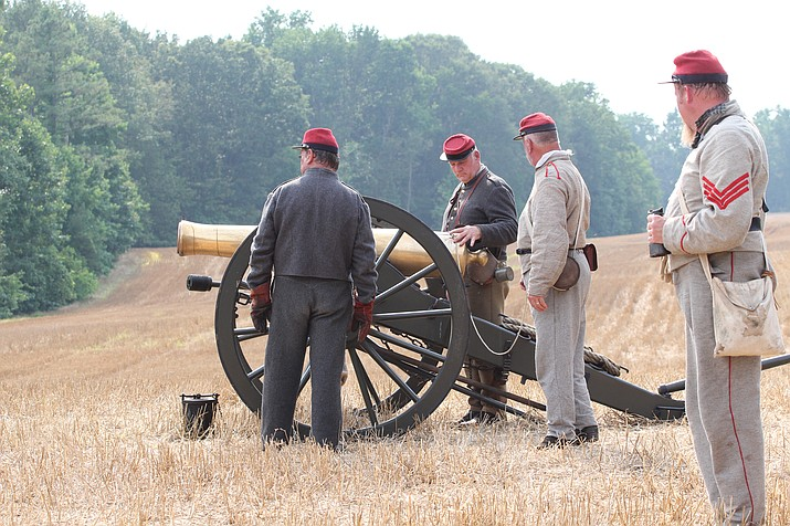 A walking tour and demonstration of the Confederate artillery position at the Poindexter Farm as part of the Battle of Malvern Hill. (Photo/NPS)