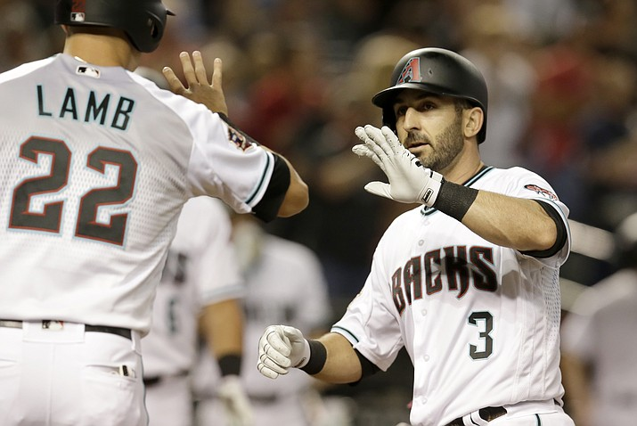 Arizona Diamondbacks Daniel Descalso (3) celebrates with Jake Lamb after hitting a two-run home run against the Cincinnati Reds during the first inning of a baseball game Tuesday, May 29, 2018, in Phoenix. (AP Photo/Rick Scuteri)