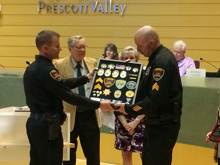 PVPD Deputy Chief James Edelstein, left, presents Sgt. Chad Kreuger with a shadowbox of his badges, patches and pins as Mayor Harvey Skoog, Vice Mayor Lora Lee Nye and council look on during the May 24 council meeting. Sgt Kreuger is retiring after 20 years with the department. (Sue Tone/Tribune)