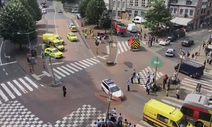In this grab taking from video Tuesday, May 29, 2018,emergency services arrive at the scene after a shooting incident, in Liege, Belgium. A gunman killed three people, including two police officers, in the Belgian city of Liege on Tuesday, a city official said. Police later killed the attacker, and other officers were wounded in the shooting. (Victor Jay)
