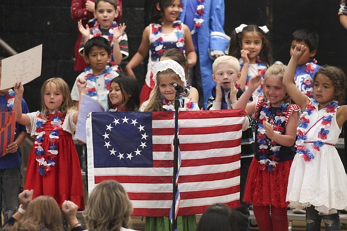 First grade students at Williams Elementary-Middle School display their patriotism and acting and singing abilities during their May 16 performance of Betsy Ross at Parenteau Auditorium in Williams. (Loretta Yerian/WGCN)