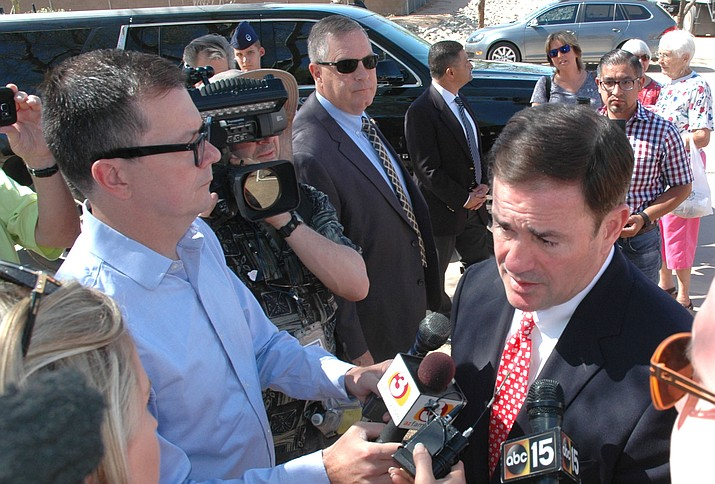 Gov. Doug Ducey answers questions Monday on his views on teaching evolution in public schools. (Capitol Media Services photo by Howard Fischer)