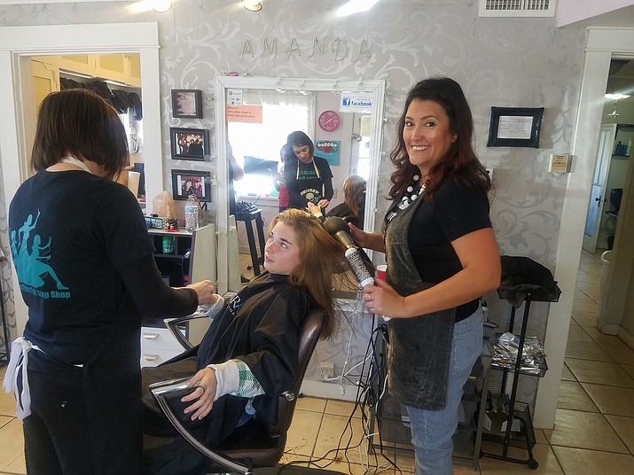 Amanda's Beauty Box provides free haircuts for select students May 22. (Submitted photo)