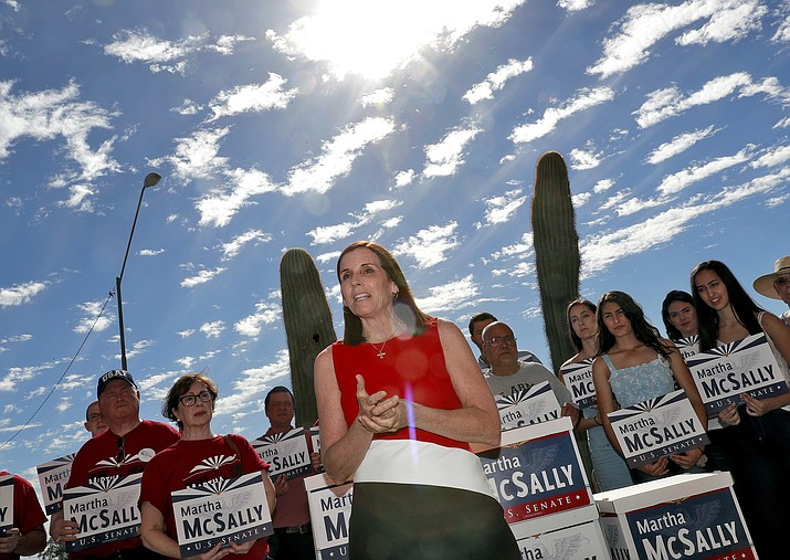 U.S. Rep. Martha McSally, R-Ariz., delivers her signatures to the Arizona Secretary of State's office Tuesday, May 29, 2018, at the Capitol in Phoenix. McSally is officially running as a Republican for U.S. Senate seat being vacated by retiring Republican Sen. Jeff Flake. Women running for office have crossed another threshold with a record number of candidates for the U.S. Senate. Actually winning those seats and changing the face of the chamber are a different matter. Many of the women jumping into Senate races face uphill campaigns. (AP Photo/Matt York)