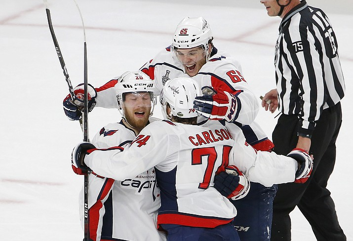 Washington Capitals center Lars Eller, left, celebrates his goal with teammates in the first period in Game 2 of the NHL hockey Stanley Cup Finals against the Vegas Golden Knights on Wednesday, May 30, 2018, in Las Vegas. (AP Photo/Ross D. Franklin)