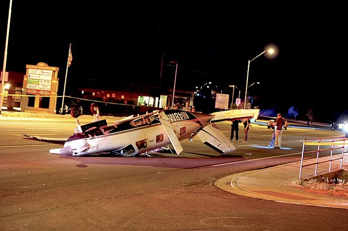 An airplane attempting to make an emergency landing on Iron Springs Road in Prescott Tuesday night struck a light pole and flipped. (Les Stukenberg/Courier)