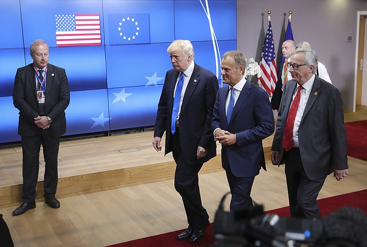 In this May 25, 2017 file photo, US President Donald Trump, center, speaks with European Council President Donald Tusk, second right, and European Commission President Jean-Claude Juncker in Brussels. The Trump administration announced Thursday, May 31, 2018 that it will impose tariffs on steel and aluminum imports from Europe, Mexico and Canada after failing to win concessions from the American allies. (AP Photo/Olivier Matthys, File)