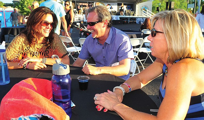 Chris Chintis, Kent Mattern, and Sherrie Thompson chat during the Third Annual Party in the Pines in downtown Prescott. (Kudos file photo)