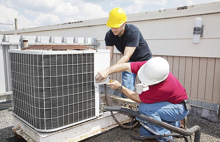 Having central air conditioning units serviced before the start of summer can ensure they run as efficiently as possible when temperatures begin to rise. (Courtesy)