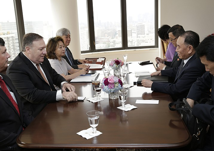 Kim Yong Chol, former North Korean military intelligence chief and one of Kim Jong Un's closest aides, second from right, and U.S. Secretary of State Mike Pompeo, second from left, sit across from one another before the start of a meeting, Thursday, May 31, 2018, in New York. (AP Photo/Seth Wenig)