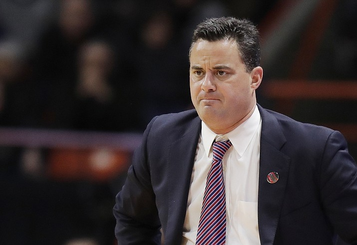 Arizona head coach Sean Miller, in this Thursday, March 15, 2018 file photo, looks on during a first-round game against Buffalo in the NCAA men's college basketball tournament in Boise, Idaho. Arizona went through one of the program's most tumultuous seasons in 2017-18. The Wildcats were ensnared in an FBI probe in recruiting before the season started, had a key player go down for a long stretch and were linked to the federal probe a second time late in the year. (Ted S. Warren/AP, File)