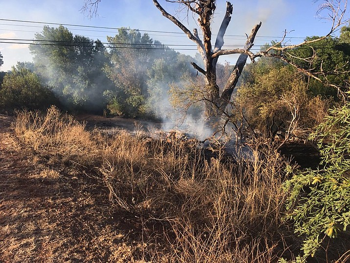 On Saturday, May 26, 2018 at about 5 p.m. a Yavapai County Sheriff's Office deputy was flagged down by a concerned citizen on Page Springs Road in Cornville regarding a brush fire burning near the bridge over Oak Creek. Officials say the fire was started by three teens who were smoking. (Yavapai County Sheriff's Office)