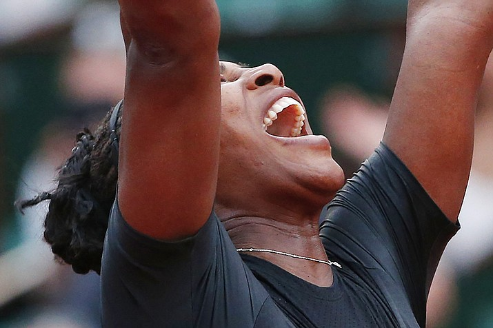 Serena Williams celebrates winning her second round match of the French Open tennis tournament against Australia's Ashleigh Barty in three sets, 3-6, 6-3, 6-4, at the Roland Garros stadium in Paris, France, Thursday, May 31, 2018. (Thibault Camus/AP)