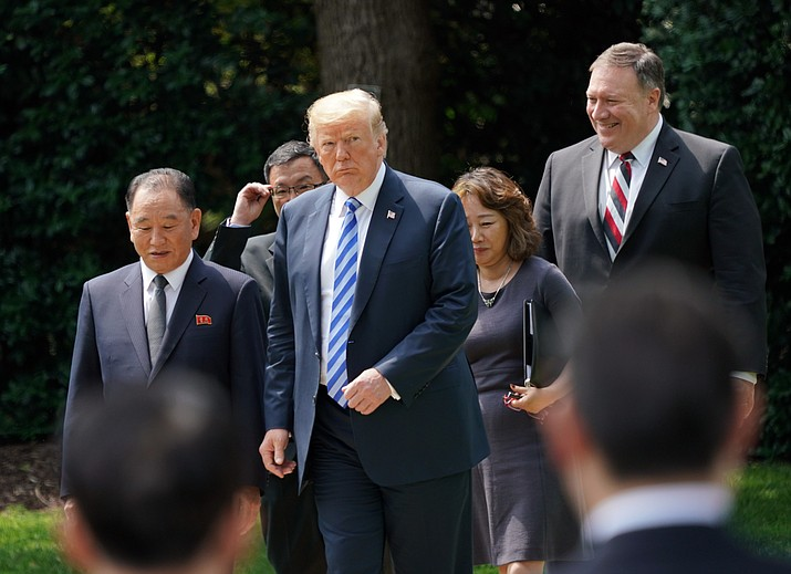 President Donald Trump walks with Kim Yong Chol, left, former North Korean military intelligence chief and one of leader Kim Jong Un's closest aides, after their meeting in the Oval Office of the White House in Washington, Friday, June 1, 2018, as Secretary of State Mike Pompeo follow at right. (AP Photo/Andrew Harnik)