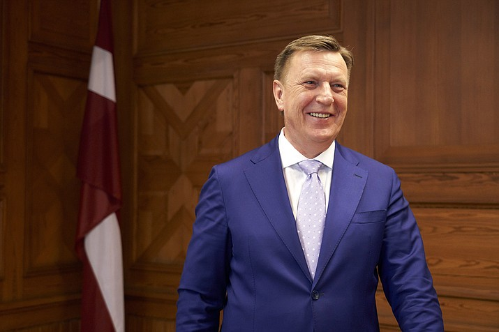 In this photo taken on Tuesday, April 10 2018, Latvia's Prime Minister Maris Kucinskis poses for a photograph, during an interview, in Riga. Latvia has come into focus as a potential weak link in the West's banking system as the U.S. and EU increasingly rely on financial sanctions as a weapon in their diplomatic spats _ with North Korea, but also Russia and Syria, among others. (AP Photo/David Keyton)