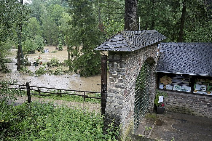 The Eifelzoo in Luenebach, western Germany, is flooded on Friday, June 1, 2018. Two lions, two tigers, a jaguar and a bear broke out of their cages after heavy rain damaged their enclosure. (Oliver Berg/dpa via AP)