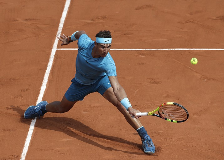 Spain's Rafael Nadal returns a ball to France's Richard Gasquet during their third round match of the French Open tennis tournament at the Roland Garros stadium, Saturday, June 2, 2018 in Paris. (Alessandra Tarantino/AP Photo)