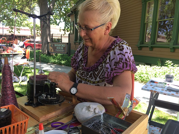 Sheila Graham makes a sock using the toe-up technique at the Sharlot Hall Museum's Folk Arts Fair Saturday. The event continues Sunday, June 3. (Jason Wheeler/Courier)