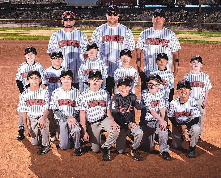 The Anderson Ford Kingman North Little League Minors. Front row from left, Fabian Bailon, Pax McFadyen, Travin Turner, Baylor Short, Vaughn Larsen and Devon Dubay. Second row from left, Rally Coglietti, J.J Feil, Cash Spencer, Forrest Lane, Demarcus Walema and Aiden Wildevaur. Back row from left, Jeremy Feil, Jason Lane, Eddie Walema.
