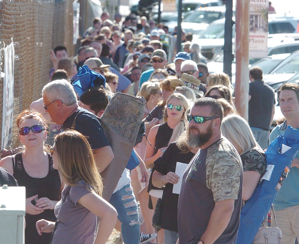 Hundreds wait for the gates to open for the Prescott Area Young Professionals 8th annual Party in the Pines at Prescott Mile High Middle School in Prescott Saturday, June 2, 2018. (Les Stukenberg/Courier)