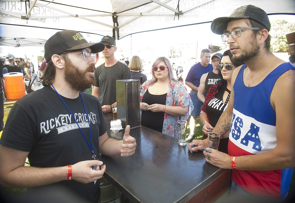 Lots of questions and sampling of beers at Prescott Area Young Professionals 8th annual Party in the Pines at Prescott Mile High Middle School in Prescott Saturday, June 2, 2018. (Les Stukenberg/Courier)