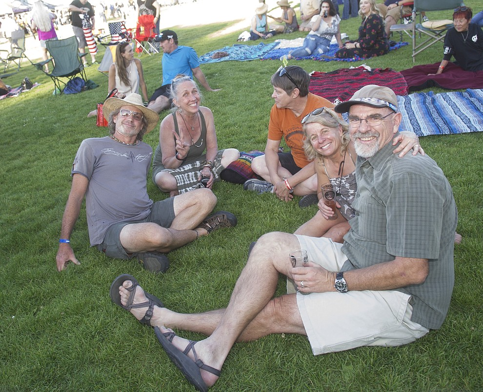 Laying on the grass enjoying the beer and music at Prescott Area Young Professionals 8th annual Party in the Pines at Prescott Mile High Middle School in Prescott Saturday, June 2, 2018. (Les Stukenberg/Courier)