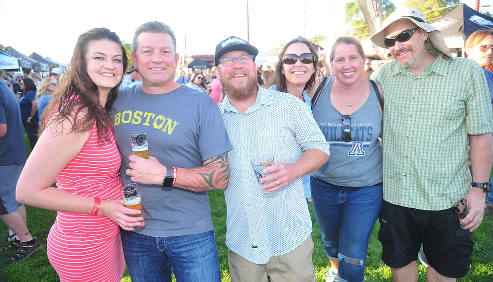 Gillian and Matt Meierbachtol, Joe and Jenna Howard, Jennifer and James Waara along with 3000 others attend the Prescott Area Young Professionals 8th annual Party in the Pines at Prescott Mile High Middle School in Prescott Saturday, June 2, 2018. (Les Stukenberg/Courier)