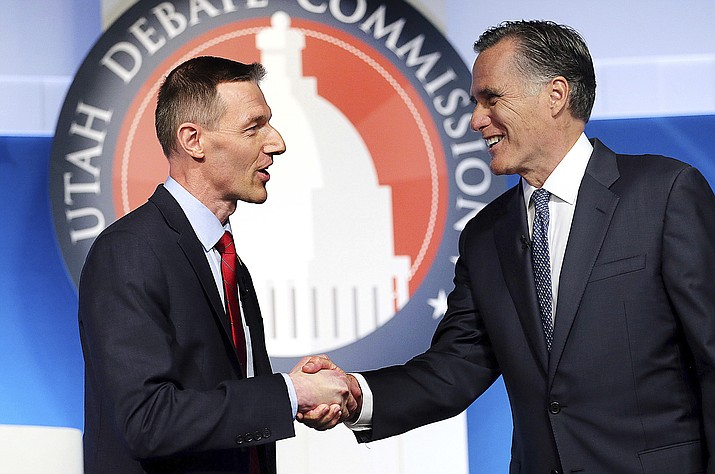 U.S. Senate candidates from Utah — state Rep. Mike Kennedy, R-Alpine, at left, and former Massachusetts Gov. Mitt Romney, now a resident of Holladay, Utah — shake hands at the beginning of a Republican primary debate, Tuesday, May 29, 2018, in Provo, Utah. (Scott G Winterton/The Deseret News via AP, Pool)