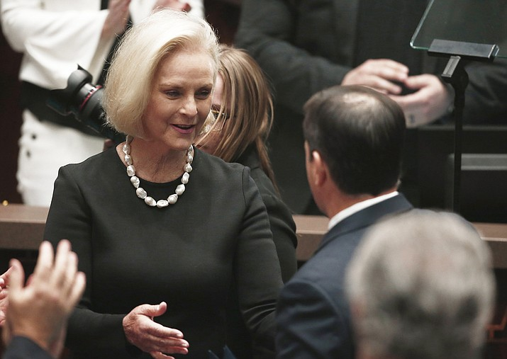 Arizona Republican Gov. Doug Ducey, right, speaks with Cindy McCain, left, wife of Arizona Republican U.S. Sen. John McCain, prior to Ducey giving his State of the State address at the capitol in Phoenix Monday, Jan. 8, 2018. (AP Photo/Ross D. Franklin)