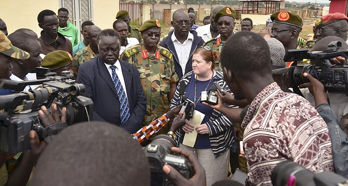 U.S. Consul Denise Knapp, center, speaks to the media, accompanied by South Sudanese army officials and ministry of foreign affairs representatives, after the body of killed American journalist Christopher Allen was officially handed over to the U.S. embassy at a mortuary in the capital Juba, South Sudan Tuesday, Aug. 29, 2017. The 28-year-old journalist was killed amid fighting between government and rebel forces near the Ugandan border. (AP Photo/Mariah Quesada)