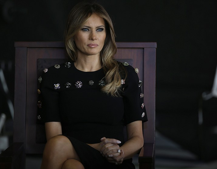 In this Saturday, May 27, 2017, file photo, first lady Melania Trump sits as President Donald Trump addresses U.S. military troops and their families at the Sigonella Naval Air Station, in Sigonella, Italy. Melania Trump won't be joining her husband at the 2018 G7 summit in Quebec or accompanying him to the meeting planned with North Korea's leader in Singapore following the G7. (AP Photo/Luca Bruno, File)