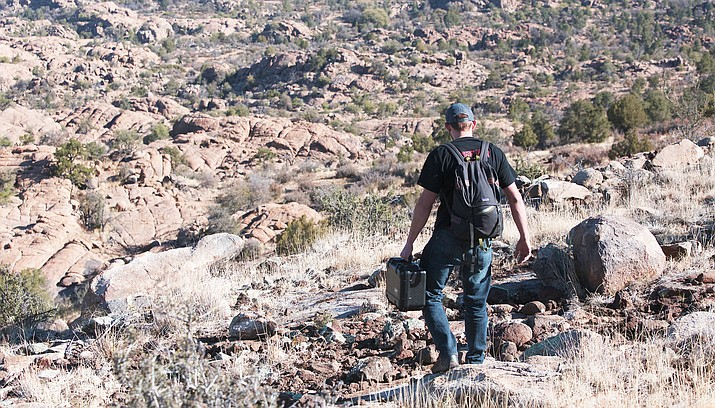 Evan White, a student in Yavapai College's Unmanned Aircraft Systems program, carries the DJI Mavick Pro in the Granite Dells. (Courtesy)